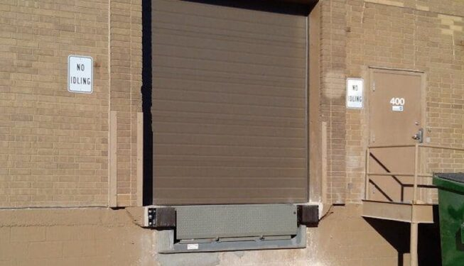 Installation of new airbag leveler and sectional steel door.